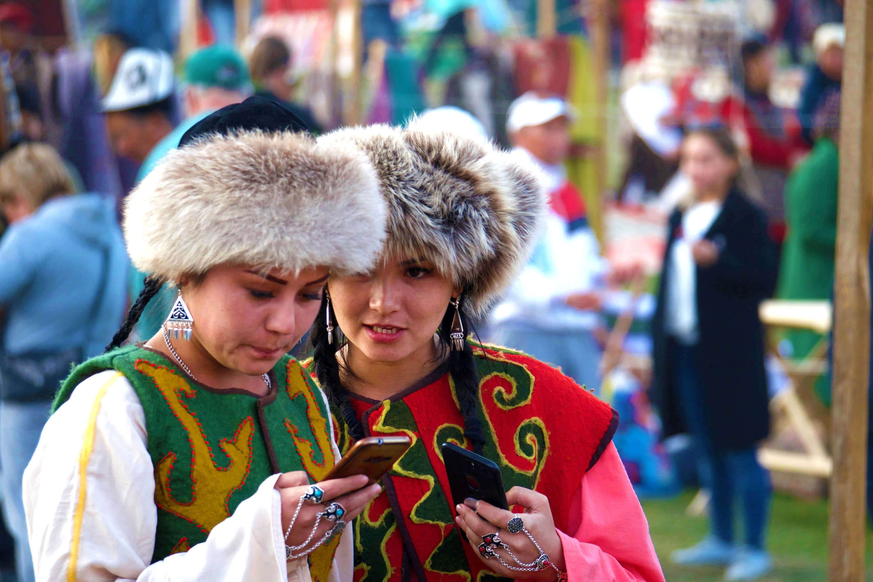 Kyrgyz girls with mobile phones.